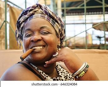 HAVANA, CUBA - MARCH 27 - Portrait of a woman smoking a cigar in a market on March 27, 2016.