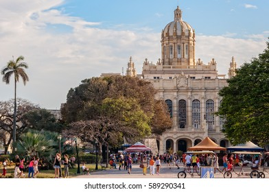 Havana, Cuba -March 6, 2016: People gather at the park in front of Museum of Revolution in Old Havana for a free music performance.