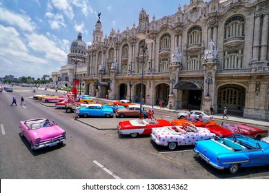 Havana, Cuba - May 08; Colorful classic cars in front of the Capitolio in Havana that is capital city of Cuba.