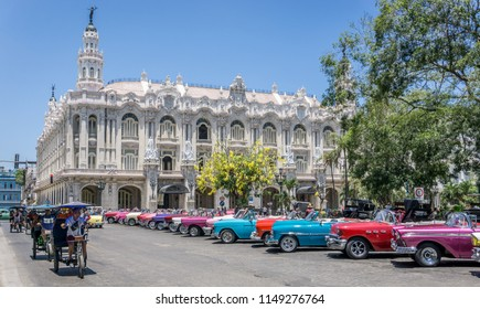 Havana, Cuba - May 10th 2018: Classic cars on Havana street with beautiful old building on background