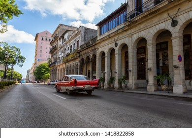 Havana, Cuba - May 13, 2019: Classic Old Car in the streets of the Old Havana City during a vibrant and bright sunny morning.
