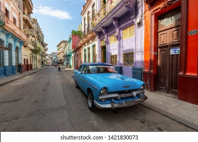 Havana, Cuba - May 14, 2019: Classic Old Taxi Car in the streets of the Old Havana City during a vibrant and bright sunny morning.