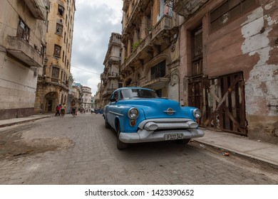Havana, Cuba - May 14, 2019: Classic Old Car in the streets of the beautiful Old Havana City during a cloudy day.