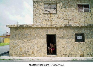 Havana, Cojímar, Cuba, MAY 17, 2017: An old man sitting in front of the door , Cojímar is a small fishing village east of Havana,It was an inspiration for Ernest Hemingway's The Old Man and the Sea