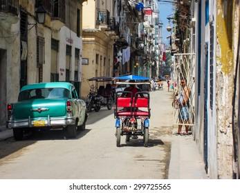 HAVANA, CUBA - MAY 20, 2012: Unidentified people on the street of Havana, Cuba. Havana is the capital city, province, major port, and leading commercial centre of Cuba.
