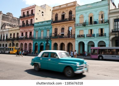 Havana / Cuba - May 2015: City trip colorful Havana, Cuba. Colorful houses and driving old timer