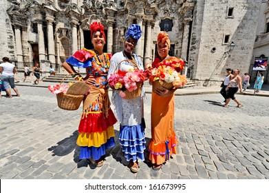 HAVANA, CUBA, MAY 6, 2009. Three Cuban women in traditional dresses in Havana, Cuba, on May 6th, 2009.
