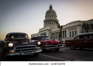 Havana, Cuba - November 06, 2017: American classic cars drives on a main road in Havana Cuba City before the Capitolio