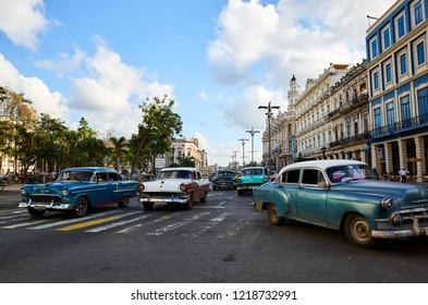 Havana, Cuba - November 06, 2017: American classic cars drives on a main road in Havana, Cuba