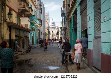 Havana, Cuba - November 06, 2017: People walking in the famous district of Habana Vieja in center of havana, Cuba