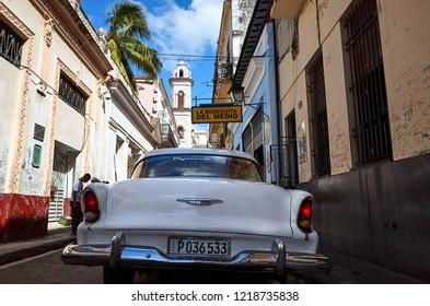 Havana, Cuba - November 06, 2017: American classic car parked on a main road in Havana, Cuba