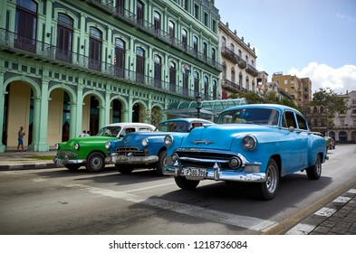 Havana, Cuba - November 06, 2017: American classic cars drives on a main road in Havana, Cuba