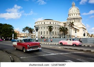 Havana, Cuba - November 06, 2017: American classic cars drives on a main road in Havana Cuba City before the Capitolio