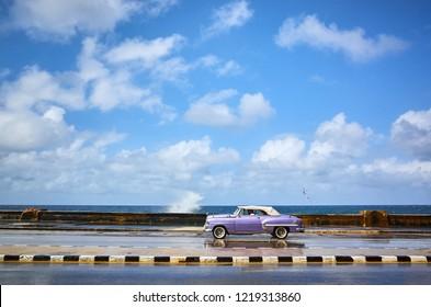 Havana, Cuba - November 06, 2017: Vintage american classic car drives on a main road Malecon in Havana, Cuba