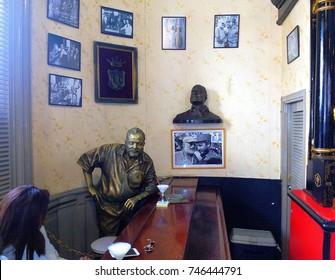 HAVANA, CUBA – NOVEMBER 1, 2017: Sculpture of Ernest Hemingway with glass of daiquiri in El Floridita, historic fish restaurant and famous cocktail bar in Old Havana / Habana Vieja, Cuba