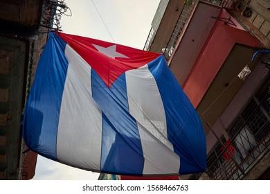 Havana, Cuba - November 15th 2019: Cuban flag between the buildings
