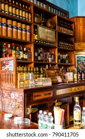 HAVANA, CUBA - NOVEMBER 16, 2017: La Bodeguita del Medio in Havana. The birthplace of mojito. View of the shelves inside the restaurant. In this pub Ernest Hemingway used to come for a drink.