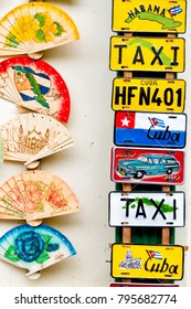 HAVANA, CUBA - NOVEMBER 17, 2017: Colorful souvenir license plates on a display. They are a popular items for sale as souvenirs and can be bought in many stores or markets in Havana, Trinidad.