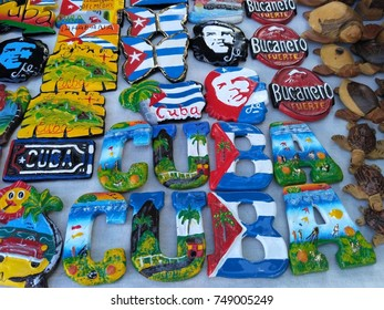 HAVANA, CUBA – NOVEMBER 2017: Cuban national flags, palm, Che Guevera portraits and other fridge magnet / souvenirs typical for Cuba sold in souvenir shop in street market in Havana Vieja / Old Havana