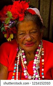 Havana, Cuba - November 26, 2011 : Portrait of african old woman in traditional Cuban clothing posing at the street of Havana, Cuba