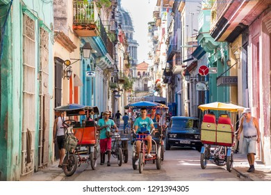 Havana, Cuba - November 29, 2017: El Capitolio seen from a narrow street