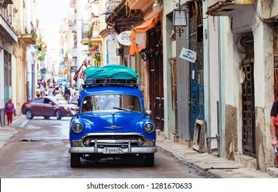 Havana, Cuba - October 03, 2018: American blue 1953 Chevrolet Bel air in the side street in the old town from Havana in Cuba - Serie Cuba Reportage