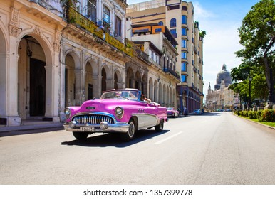 Havana, Cuba - October 03, 2018: American pink 1953 Buick Special 46C convertible vintage car on the street Jose Marti in the old town from Havana City Cuba - Serie Cuba Reportage