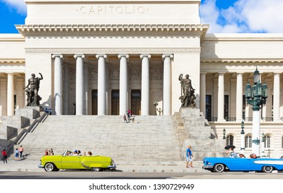 Havana, Cuba - October 04, 2018: American 1958 blue Ford Edsel Ranger Sedan and a 1953 yellow Chevrolet Bel Air convertible before the famous Capitolio in Havana City Cuba - Serie Cuba Reportage