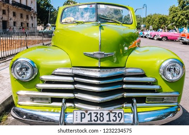 HAVANA, CUBA - OCTOBER 14, 2018: American green vintage convertible car parked on a wide street in Old Havana, Cuba.