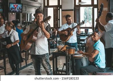 Havana, Cuba - October 18, 2019: Cuban band performing live music in the bar Dos Hermanos , Havana, Cuba.
