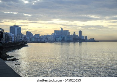 Havana, Cuba - October 2, 2014: Surreal twilight over Malecon seawall with the picturesque city as a skyline