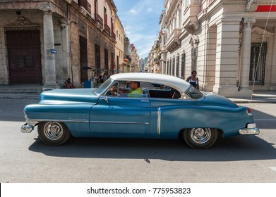 HAVANA, CUBA - OCTOBER 20, 2017: Colorful Havana Old Town Architecture and Old Car