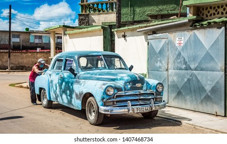 Havana, Cuba - October 21, 2018: HDR - American blue green 1954 Chrysler Windsor vintage car is being restored in the suburb from Havana City Cuba - Serie Cuba Reportage
