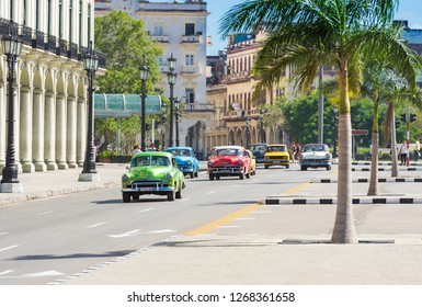 Havana, Cuba - October September 03, 2018: American red Oldsmobile, pink Chevrolet convertible vintage car on the street in the old town from Havana City Cuba - Serie Cuba Reportage