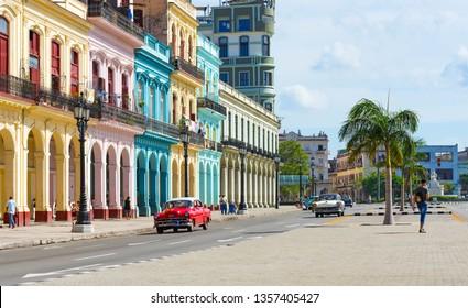 Havana, Cuba - October September 03, 2018: American red Oldtimer on the main street from Havana City Cuba - Serie Cuba Reportage