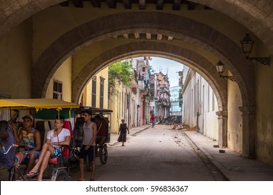 Havana, Cuba on December 23, 2015: Streetscene of Cuban people in bicycle taxi