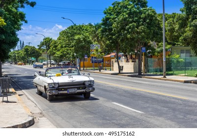 Havana, Cuba - September 03, 2016: American white classic car drive on the street in Cuba - Serie Cuba 2016 Reportage