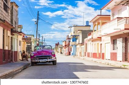 Havana, Cuba - September 16 2018: American 1953 pink Chevrolet Bel Air convertible vintage car parked in the sidestreet in Havana Cuba - Serie Cuba Reportage