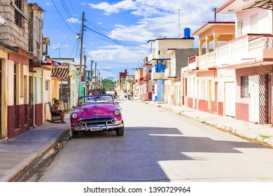 Havana, Cuba - September 19 2018: American 1953 pink Chevrolet Bel Air convertible vintage car parked in the sidestreet in Havana Cuba - Serie Cuba Reportage