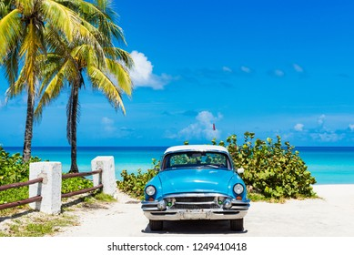 Havana, Cuba - September 24, 2018: American blue Buick classic car parked direct on the beach in Varadero Cuba - Serie Cuba Reportage