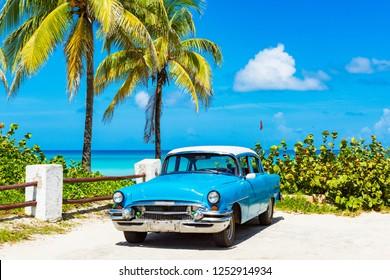 Havana, Cuba - September 24, 2018: American blue Buick parkedclassic car parked on the beach in Varadero Cuba - Serie Cuba Reportage