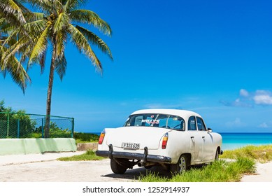 Havana, Cuba - September 24, 2018: American white Chevrolet vintage car parked on the beach in Varadero Cuba - Serie Cuba Reportage