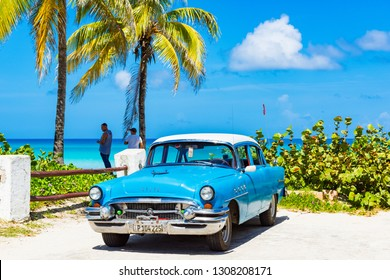 Havana, Cuba - September 24, 2018: American blue 1955 Buick Roadmaster classic car parked on the beach in Havana Cuba - Serie Cuba Reportage