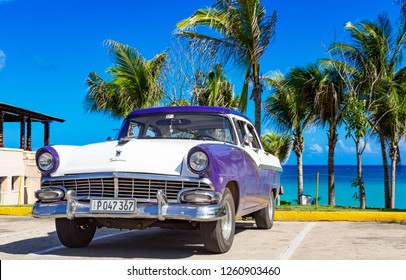 Havana, Cuba - September 28, 2018: American blue white 1956 Ford Fairlane vintage car parked on the beach in Varadero Cuba - Serie Cuba Reportage