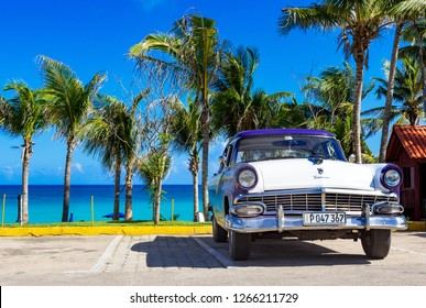 Havana, Cuba - September 28, 2018: American blue white 1954 Ford Fairlane vintage car parked on the beach in Varadero Cuba - Serie Cuba Reportage