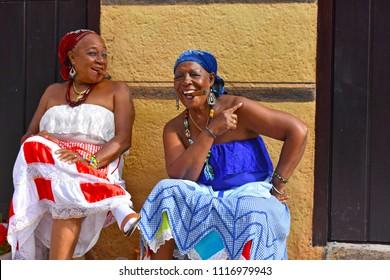 Havana, Cuba-April 7 2018: Two women smoke cigars outside a cafe