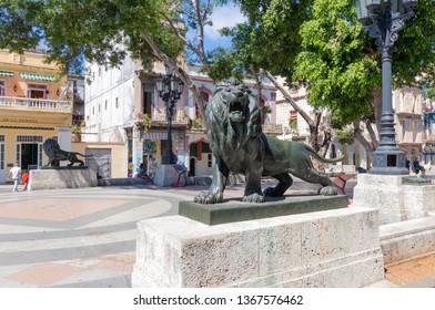 HAVANA, CUBA-FEBRUARY 22, 2019: Bronze lions in El Prado avenue, Old Havana.