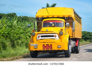 Havana, Cuba-July 8, 2018:Large yellow American truck transformed to transport passengers between cities. Private operators of trucks are somehow solving the many transportation problems in the island