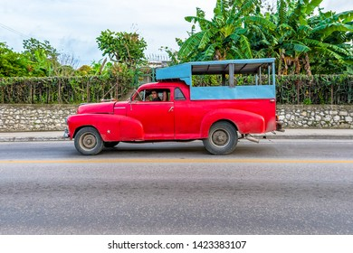 Havana, Cuba-May 22, 2019:Small red American truck empty. Cuban old obsolete cars vehicles in action are common in the Caribbean island