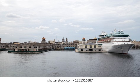 Havana, Cuba-November 30 2018: A cruise ship is docked at the port in Havana on November 30, 2018. The rebuilt pier sits in contrast to crumbling buildings. Tourism dollars help rebuild the city.